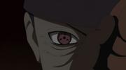Tobi taking his mask off