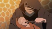 El Hombre Enmascarado amenazando a Naruto