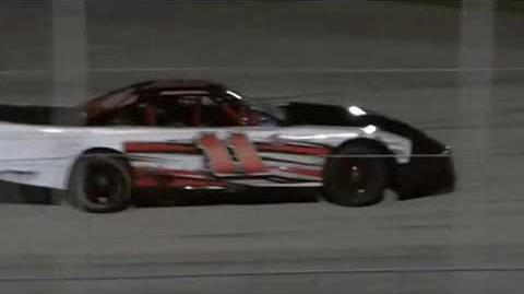 Sportsman driver ignores black flag, refuses to leave track.