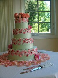 Pink decorated wedding cake