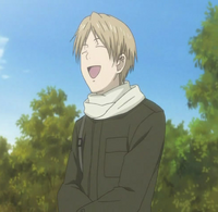 Natsume laughing at the fallen nyanko