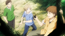 Kitamoto and Nishimura finding Natsume's reactions entertaining
