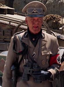 Standartenführer licking his lips