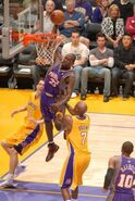 Jason richardson dunks on lamar odom