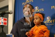 Kobe Bryant laughs with his daughter Natalia while talking to the press