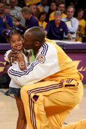 Kobe kissing Natalia