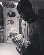 Kyrie holding his newborn daughter azurie