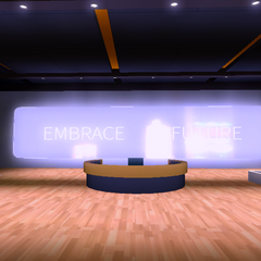 Front desk with 'Embrace Future' on the wall