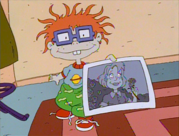 File:Chuckie with photo of Melinda.jpg