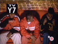Kenan, Kel and Coolio sitting on the Big Orange Couch