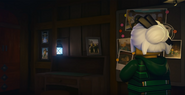 EP77 Harumi looking at Sensei Garmadon's photo