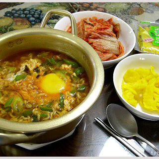 Ra-myun with Kimchi and yellow radish pickle.