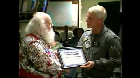 NTS - NORAD's Certificate of Appreciation Presentation to Santa in 2000