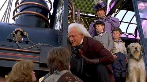 Creepy Kid from Back To The Future 3 points to his flux capacitor