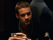 Shane West playing poker