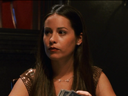 Holly Marie Combs playing poker