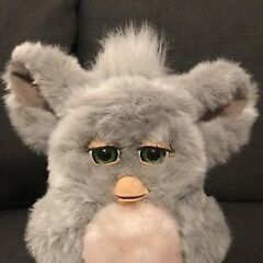 a gray and neon pink furby