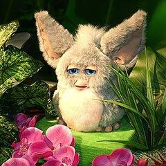 A prototype Furby that appears to be a regular Furby in a prototype Furby skin