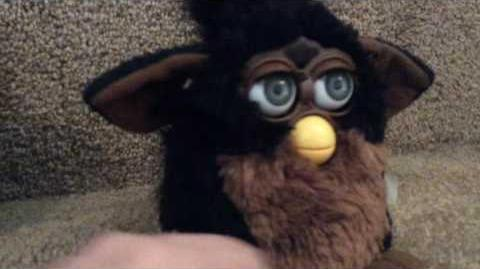 The 1998 furby in a video.