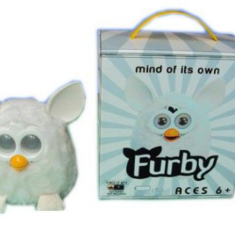 A Phoebe with it's box that displays the Furby logo instead of the Phoebe logo.
