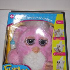 A Pink Italian Furby Baby in its box