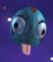 Teal Egg-Shaped Planet with Red Spots and Pink Tongue