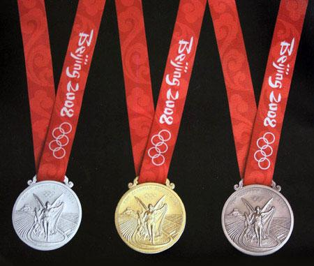 File:Olympic medals front.jpg