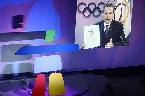File:Chairmain of the IOC Calls In.jpg