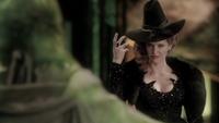 5x18 Zelena arrête Dorothy dos magie verte main levée Oz
