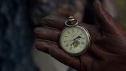7x18 Robin main gant marron horloge à l'envers