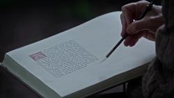 4x16 modification livre de contes plume de l'auteur Isaac Heller main