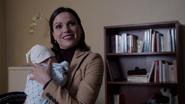 309 Regina sourire Henry bébé