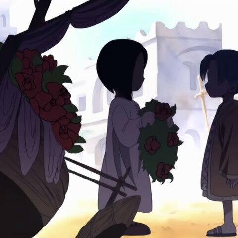 Die kleine Lasa überreicht Vivi einen Blumenkranz.