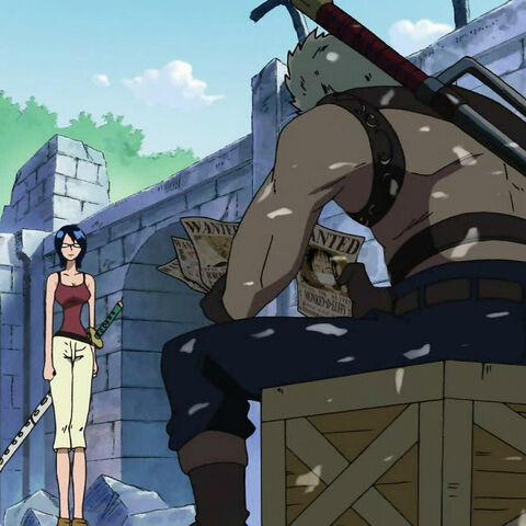 Smoker und Tashigi besprechen die neuen Steckbriefe für Luffys Mannschaft.
