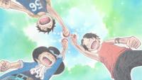 Les trois frères partageant le saké