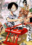 Rozdział 269 Luffy w białej koszulce z czarną czaszką i tęczowych spodniach ćwiczy kaligrafię