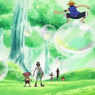 Luffy balanciert vor Usopp und Chopper auf einer der Luftblasen.