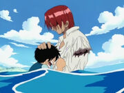 Shanks lässt für Luffy den Arm
