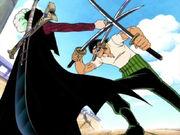 Mihawk hält Zoro mit einem Dolch auf