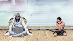 Garp piange al fianco di Ace sul patibolo