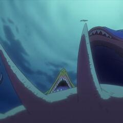 Billy und Nami werden von Seemonstern umringt.