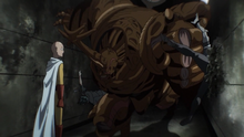Carnage Kabuto punches Genos into the wall