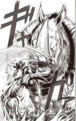 Iaian deflects Rhino Wrestler's attack