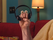 Oobi-Make-Pizza-Grampu-with-headphones