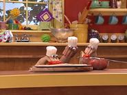Oobi-Make-Pizza-squishing-tomatoes