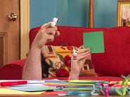 Oobi-Make-Art-Uma-holds-up-a-square
