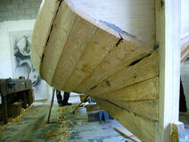 The lower boards are steamed and twisted
