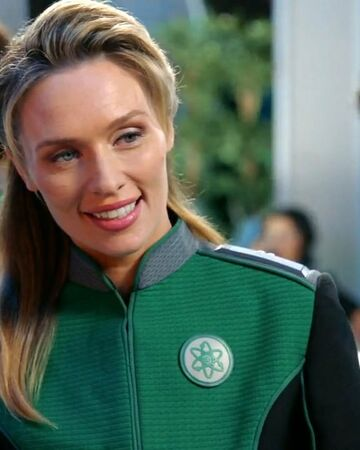 Character shown wearing green with the science badge