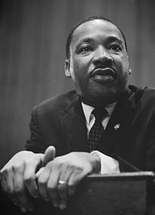 220px-Martin-Luther-King-1964-leaning-on-a-lectern