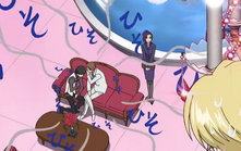 Yuzuru whispering to kyouya